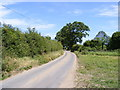 TG0429 : Country Lane off Thurning Road by Adrian Cable