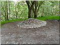 NN7623 : Stone chippings at the edge of Laggan Wood by Anthony O'Neil