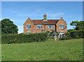 TQ5409 : Parkwood Farm Cottages by Simon Carey