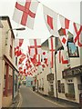 SW9175 : Flags in Lanadwell Street, Padstow by Derek Harper