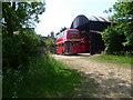 TF0700 : A London bus at Sacrewell Lodge Farm by Marathon