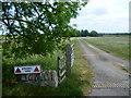 TF0604 : The entrance to Windmill Farm by Marathon