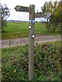 TM3387 : Footpath signpost on Flixton Airfield by Glen Denny