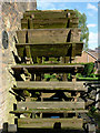 SJ9752 : Mill wheel at Cheddleton Flint Mill, Staffordshire by Roger  Kidd
