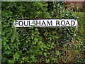 TG0127 : Foulsham Road sign by Adrian Cable