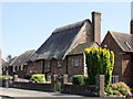 TV4999 : Thatched mock-medieval cottage, Seaford by nick macneill