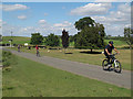 SK7904 : Cyclists passing Launde Abbey by Stephen Craven