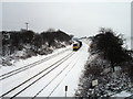 SO9567 : Southbound Freight Train in the Snow by Rob Newman
