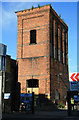TQ3380 : Hydraulic accumulator tower, Mansell Street by Chris Allen