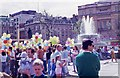 TQ2980 : Tourists in Trafalgar Square (1) by Peter Shimmon