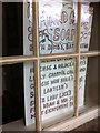 SE0925 : Grocer's apostrophe's -  close up of a sign in an empty unit at the Piece Hall, Halifax by Phil Champion