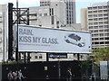 TQ3180 : Rain Kiss my Glass advert near Blackfriars Bridge by PAUL FARMER
