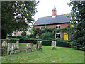 TM2972 : Cottages beside All Saints' churchyard, Laxfield by Evelyn Simak