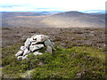 NO4689 : The cairn on Little Cock Cairn looking west by Mike Dunn