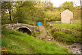 SK0567 : Packhorse bridge over the River Dove at Washgate by Adrian Channing