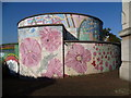 TQ3076 : Decorated ventilation shaft in Stockwell Memorial Gardens by Ian Yarham