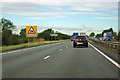 TL3367 : Farm traffic warning on A14 by Robin Webster