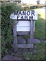 TM3374 : Manor Farm sign by Adrian Cable