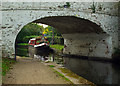 TQ0581 : View of narrowboat through Bridge 189, Grand Union Canal by Julian Osley