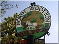 TF6424 : North Wootton Village Sign by Theo Foster