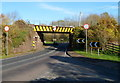 SO6913 : Railway bridge over a tight bend in the A48, Broadoak by John Grayson