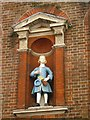 TQ3480 : The (former) Raine Street charity school, E1 - Bluecoat boy statue by Mike Quinn