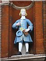 TQ3480 : The (former) Raine Street charity school, E1 - Bluecoat boy statue (2) by Mike Quinn