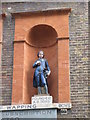 TQ3480 : The (former) St. John's School, Scandrett Street, E1 - Bluecoat boy statue by Mike Quinn