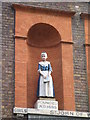 TQ3480 : The (former) St. John's School, Scandrett Street, E1 - Bluecoat girl statue by Mike Quinn