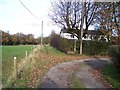 SD5910 : Public Footpath sign shows the right of way by Raymond Knapman