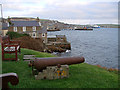 HY2508 : Guarding Stromness Harbour by John Lucas