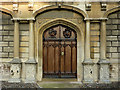 TL4457 : The Chapel door at Peterhouse, Cambridge by Roger  Kidd
