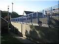 SX9372 : Fences to a ramp and a bowling green, Teignmouth by Robin Stott