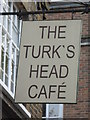 TQ3480 : Sign for The Turk's Head Caf&eacute;, Tench Street / Green Bank, E1 by Mike Quinn