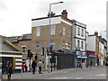 TQ4378 : Shops on Woolwich New Road by Stephen Craven