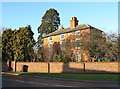 Attractive brick house from around 1800 - seen to better advantage with the leaves missing from the trees. Listed Grade II.