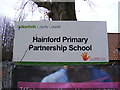 TG2219 : Hainford Primary Partnership School sign by Adrian Cable