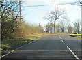 SP6535 : A422 past Water Stratford Woods by John Firth