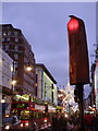 TQ2881 : London: covered traffic light in Oxford Street by Chris Downer