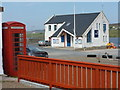 HU3455 : Aith: telephone box and lifeboat station by Chris Downer