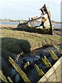 SD3446 : Old wooden wreck, Fleetwood Marsh by Peter Bond