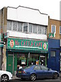 TQ2183 : McCauls Cafe, Craven Park Road, NW10 by Mike Quinn