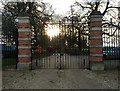 SP9630 : Lodge gates at sunset by Michael Trolove