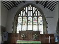 The glass in this window dates back to the 15th C, and was saved by parishioners from being destroyed by the Puritans.