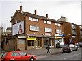 ST6168 : Sturminster Road shops by Neil Owen