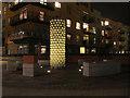 TQ3979 : Illuminated artwork, Greenwich Millennium Village by Stephen Craven