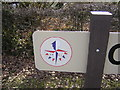 TL1058 : Colmworth village sign: detail (Festival of Britain logo) by Christopher Hilton