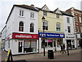 SO9570 : Bromsgrove High Street  Oulsnams & Max Spielmann by Roy Hughes