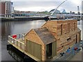 NZ2564 : Floating water mill, 'Flow', docked on the Quayside by Andrew Curtis