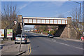 SJ7995 : This railway bridge, for me, signals the start of the Trafford Park Industrial Estate by Ian Greig